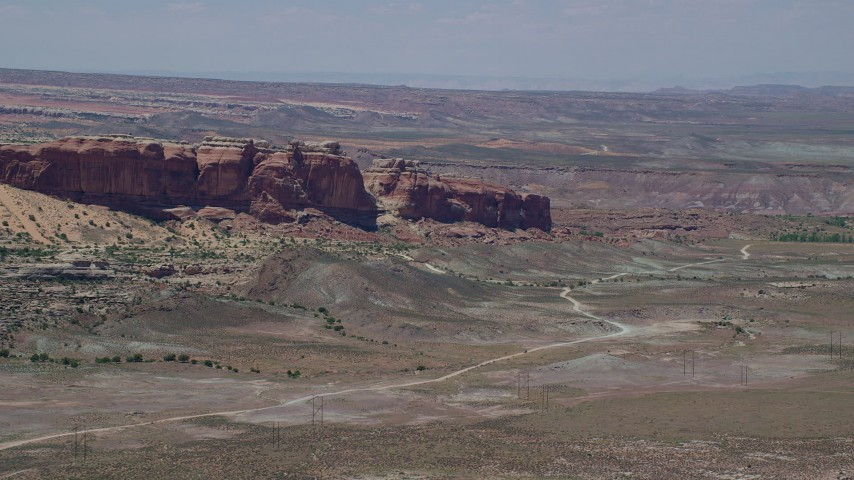6K stock footage aerial video of flying by Cotter Mine Road and desert rock formations, Moab, Utah Aerial Stock Footage | AX136_291