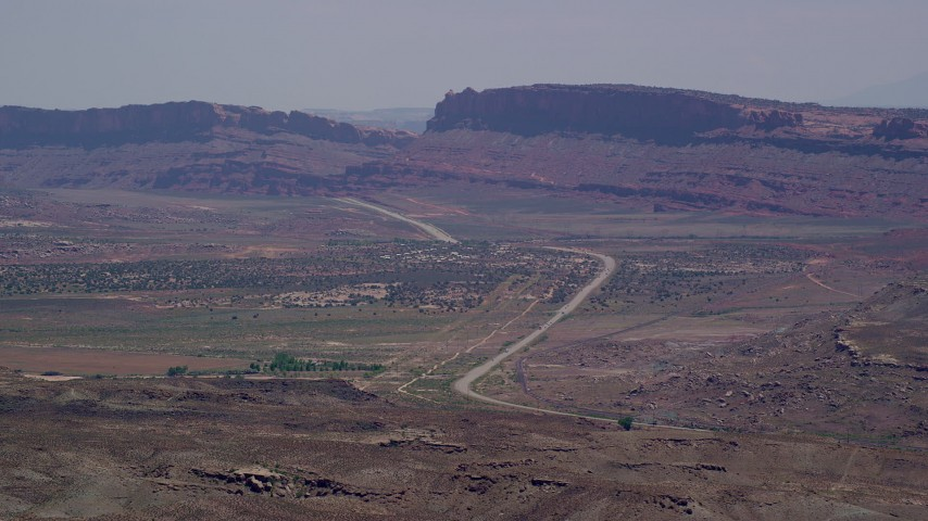 Flying by Highway 191 through desert valley, Moab, Utah Aerial Stock Footage | AX137_002
