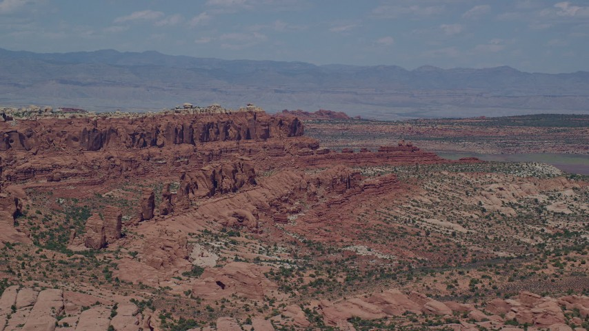 6K stock footage aerial video of flying by Klondike Bluffs and Marching Men rock formations, Arches National Park, Utah Aerial Stock Footage | AX137_003