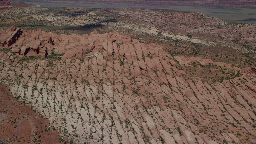 6K stock footage aerial video of flying by and tilting to desert rock formations, Arches National Park, Utah Aerial Stock Footage | AX137_004