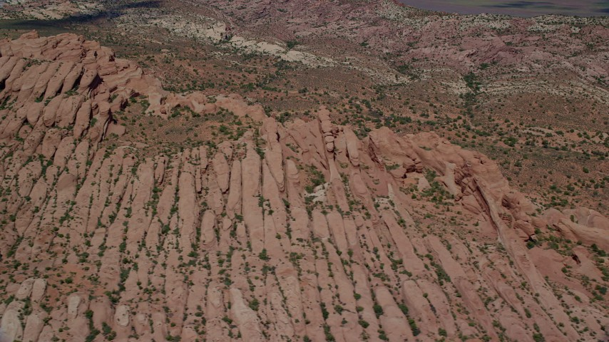 6K stock footage aerial video of flying by desert rock formations at Arches National Park, Utah Aerial Stock Footage | AX137_005