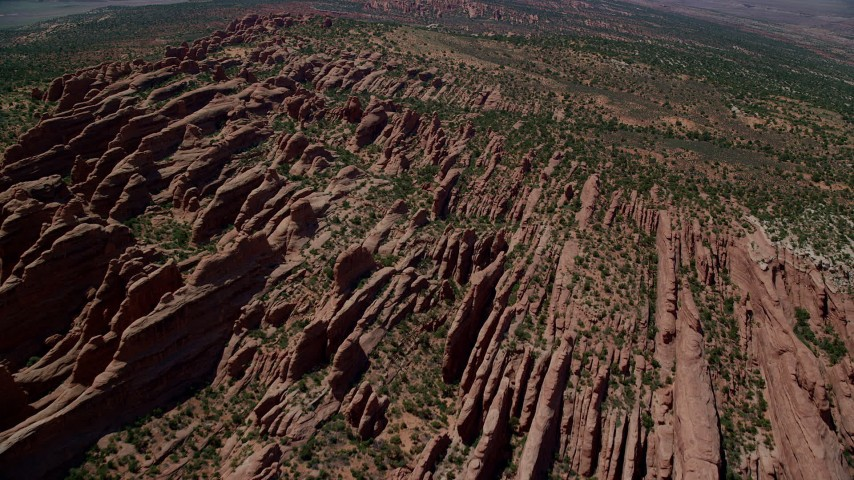 Flying over rock fins, Devil's Garden, Arches National Park, Utah Aerial Stock Footage | AX137_015