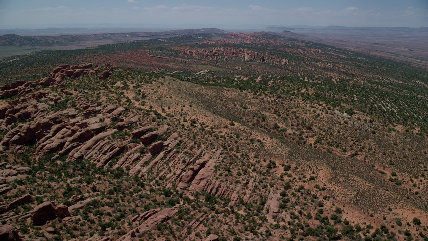 6K stock footage aerial video of passing over rock fins in Devil's Garden, Arches National Park, Utah Aerial Stock Footage | AX137_016