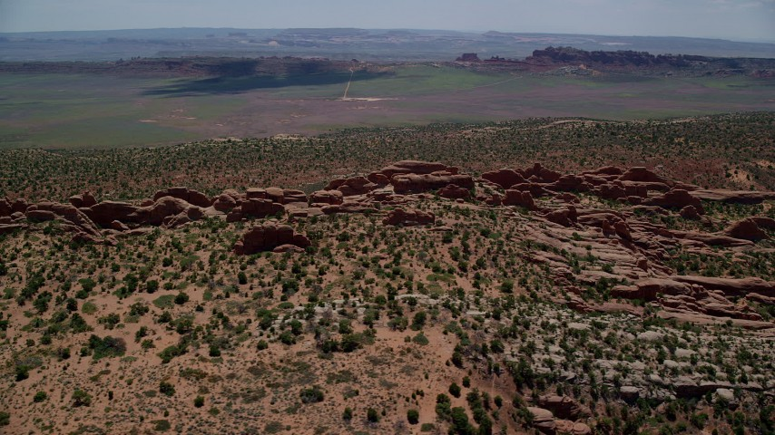 6K stock footage aerial video of a view of rock fins in Devil's Garden, Arches National Park, Utah Aerial Stock Footage | AX137_017