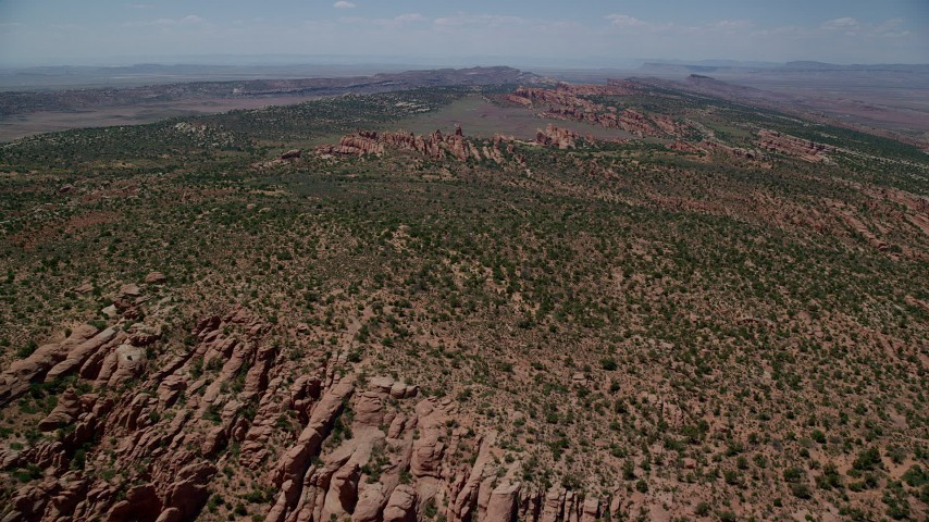 6K stock footage aerial video of a view of rock fins and desert plants in Devil's Garden, Arches National Park, Utah Aerial Stock Footage | AX137_019
