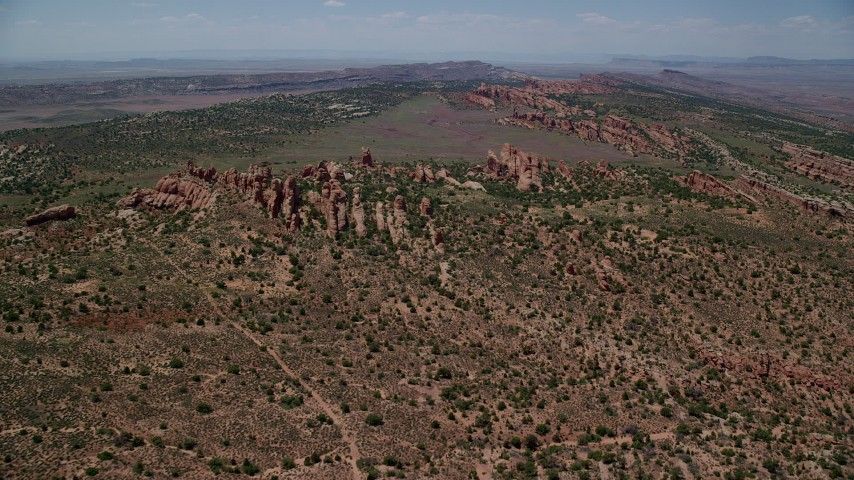 Approach rocky landscape, Devil's Garden, Arches National Park, Utah Aerial Stock Footage | AX137_020