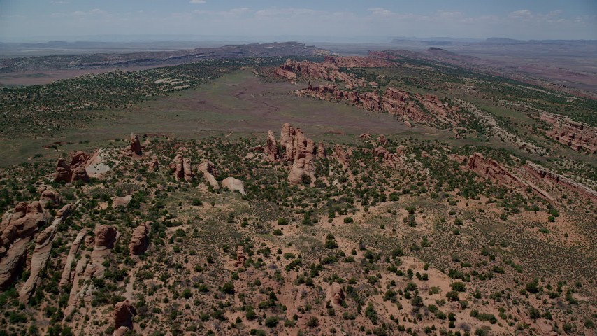 6K stock footage aerial video fly over Devil's Garden, approach dry river bed and Eagle Park, Arches National Park, Utah Aerial Stock Footage | AX137_021