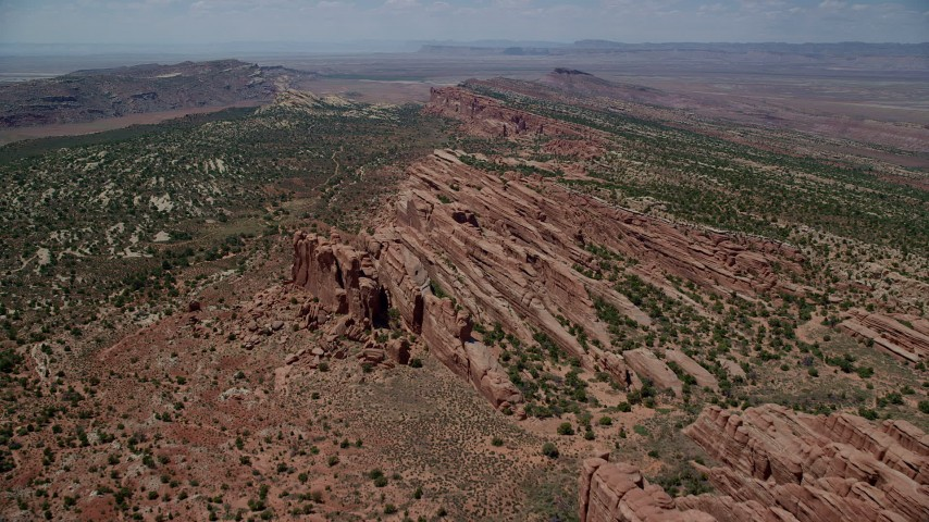 6K stock footage aerial video of a flight over rock fins toward desert plants in Eagle Park, Arches National Park, Utah Aerial Stock Footage | AX137_025