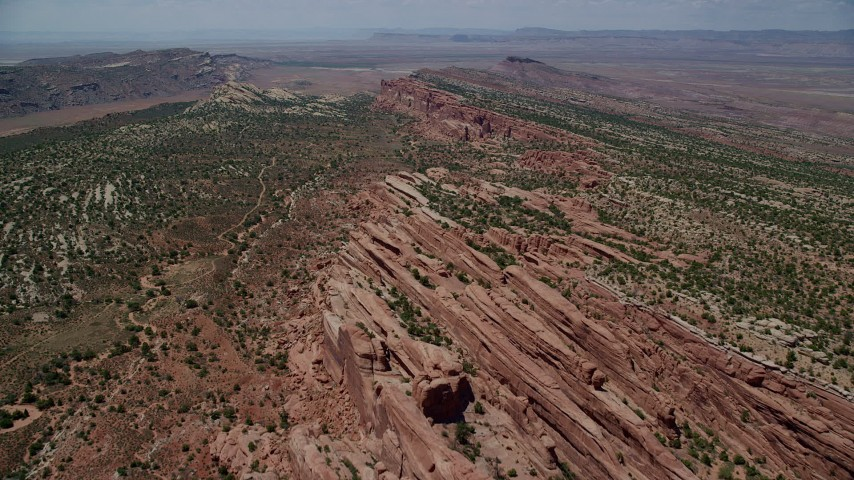 6K stock footage aerial video of passing over rock fins and vegetation in Eagle Park, Arches National Park, Utah Aerial Stock Footage | AX137_026