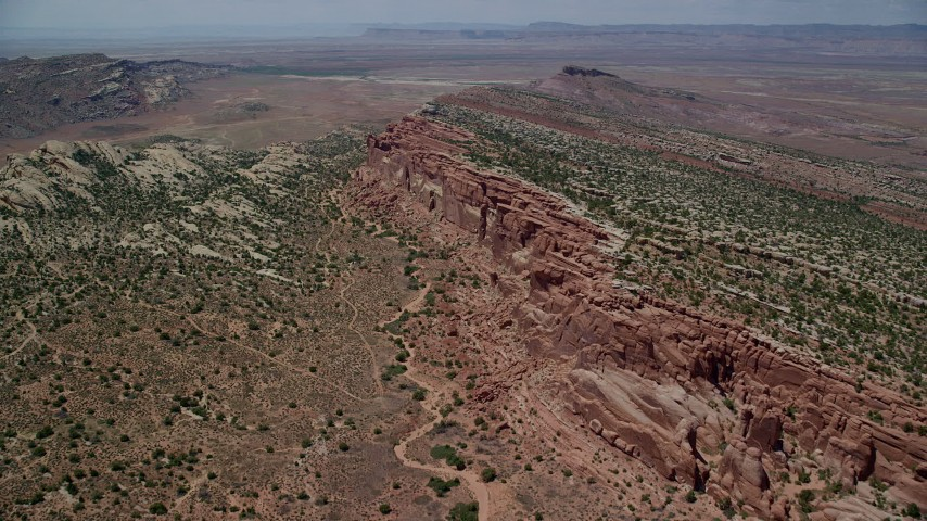 Fly over desert and vegetation, Eagle Park, Arches National Park, Utah Aerial Stock Footage | AX137_028