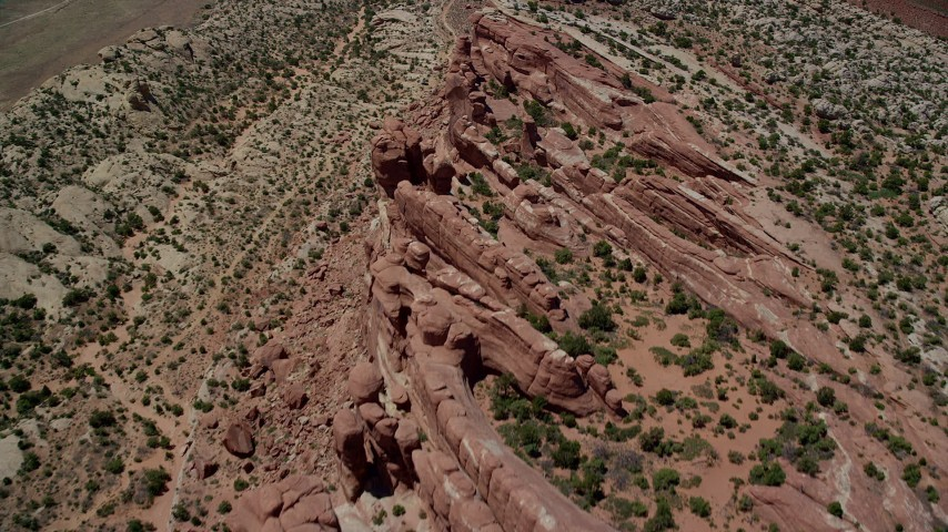 6K stock footage aerial video tilt to bird's eye of desert cliffs in Eagle Park, Arches National Park, Utah Aerial Stock Footage | AX137_030