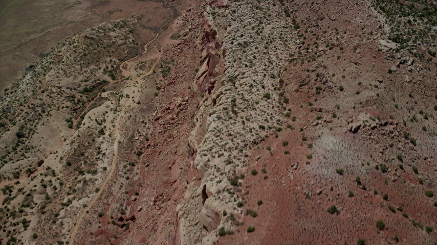 Bird's eye of desert cliffs, Eagle Park, Arches National Park, Utah Aerial Stock Footage | AX137_031
