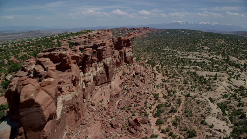 Fly along cliffside rock formations, Eagle Park, Arches National Park, Utah Aerial Stock Footage | AX137_033