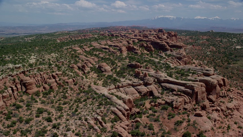 6K stock footage aerial video fly over rock formations and green desert vegetation in Eagle Park, Arches National Park, Utah Aerial Stock Footage | AX137_037
