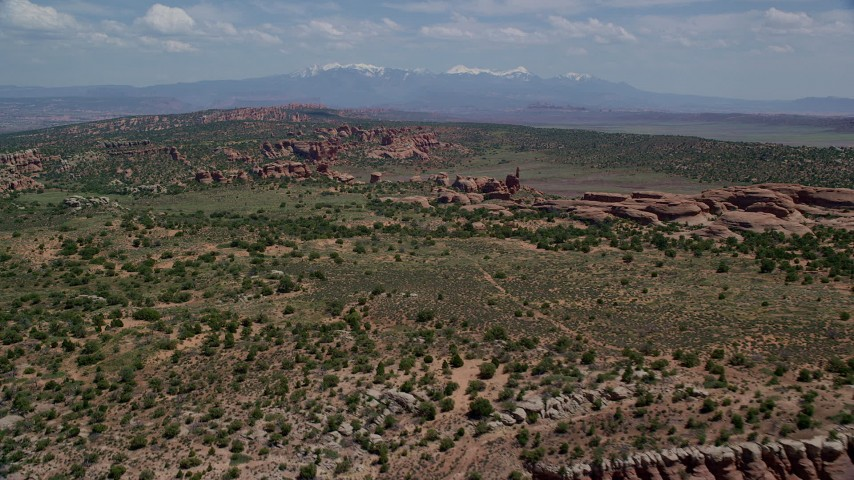 6K stock footage aerial video of Eagle's Rock and Devil's Garden in Arches National Park, Utah Aerial Stock Footage | AX137_040