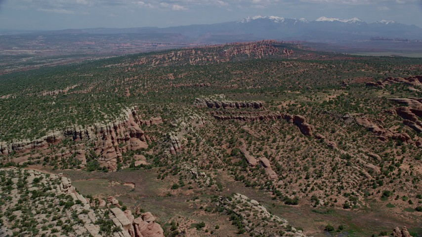 6K stock footage aerial video approach cliffs with vegetation in Devil's Garden, Arches National Park, Utah Aerial Stock Footage | AX137_042