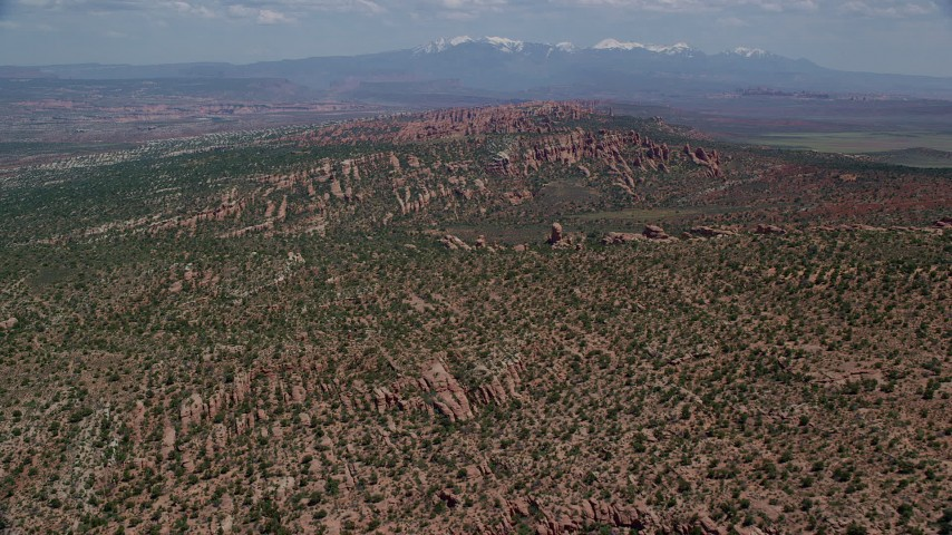 6K stock footage aerial video fly over desert rock formations and plants in Devil's Garden, Arches National Park, Utah Aerial Stock Footage | AX137_044