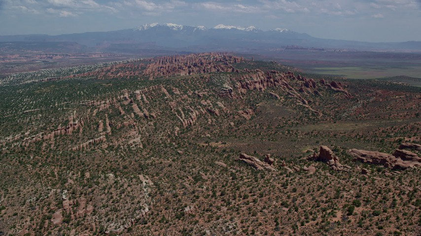 6K stock footage aerial video fly over and approach rock formations in Devil's Garden, Arches National Park, Utah Aerial Stock Footage | AX137_045
