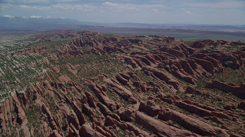 6K stock footage aerial video of passing by Devil's Garden rock fins at Arches National Park, Utah Aerial Stock Footage | AX137_050