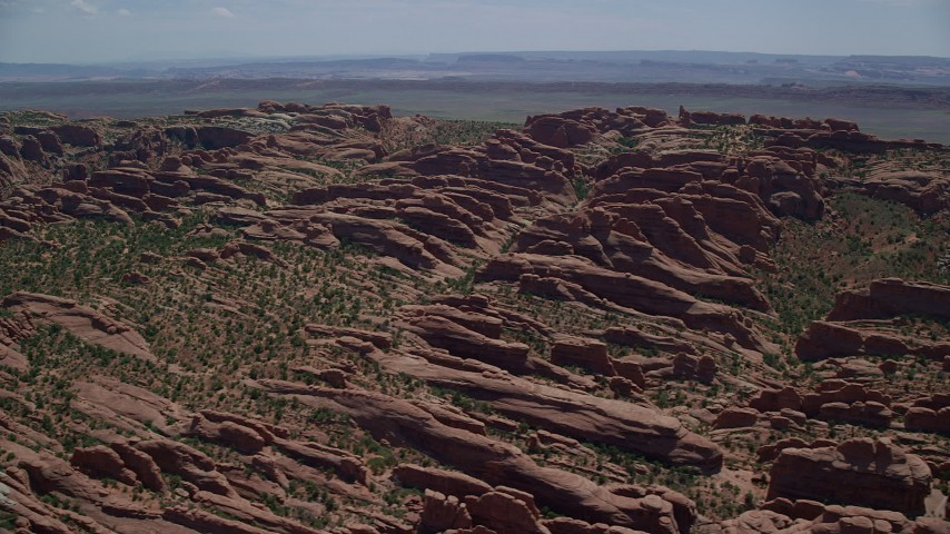 6K stock footage aerial video of a view of Devil's Garden rock fins at Arches National Park, Utah Aerial Stock Footage | AX137_051