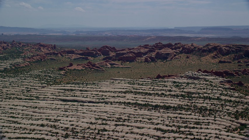 6K stock footage aerial video of Devil's Garden desert rock formations at Arches National Park, UT Aerial Stock Footage | AX137_053