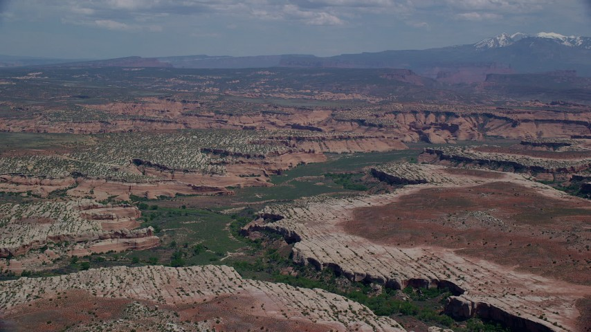 6K stock footage aerial video of approaching Salt Wash Canyons at Arches National Park, Utah Aerial Stock Footage | AX137_055