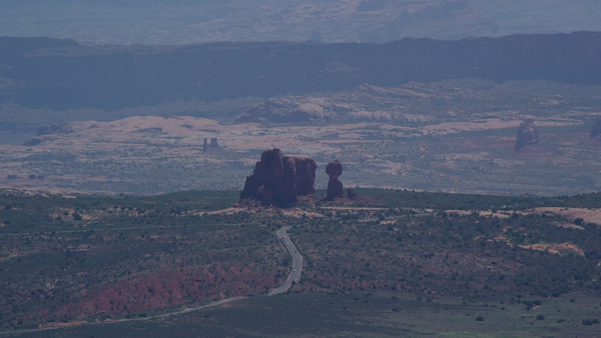 6K stock footage aerial video of a view of Balanced Rock and Scenic Drive, Arches National Park, Utah Aerial Stock Footage | AX137_060