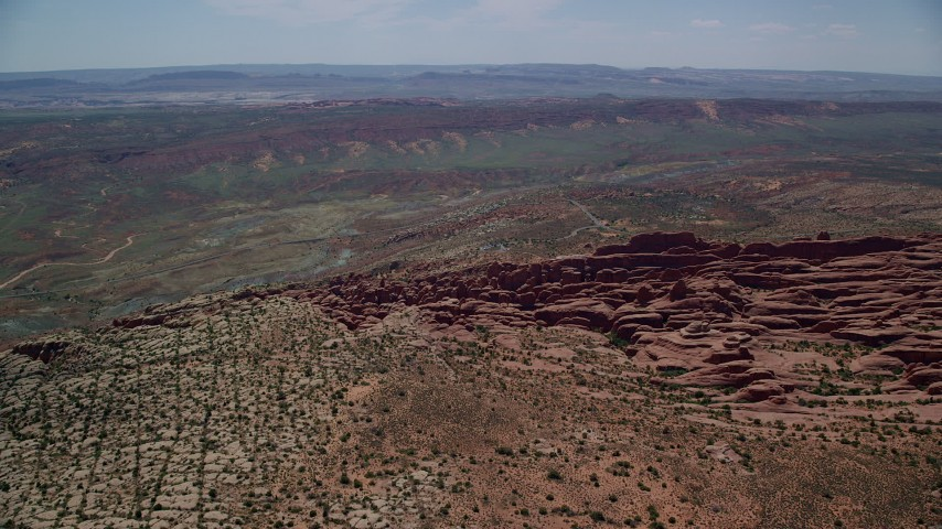 6K stock footage aerial video of orbiting Fiery Furnace rock fins and formations at Arches National Park, Utah Aerial Stock Footage | AX137_061
