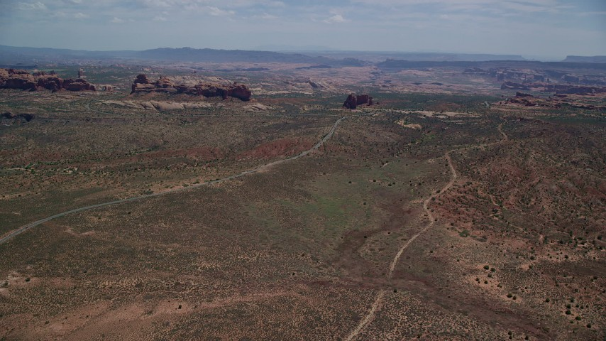 6K stock footage aerial video approach Ham Rock and Balanced Rock near Arches Scenic Drive, Arches National Park, Utah Aerial Stock Footage | AX137_063