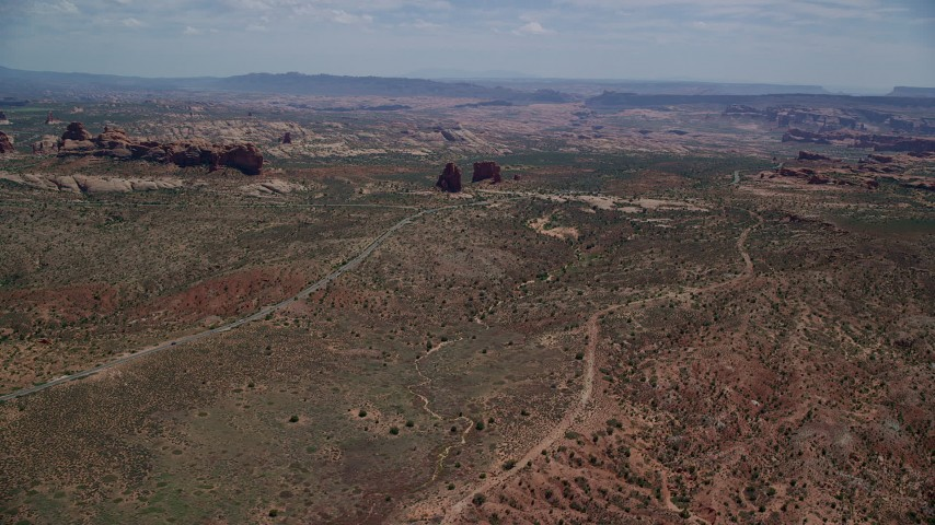 6K stock footage aerial video of flying by Ham Rock and Balanced Rock near Arches Scenic Drive, Arches National Park, Utah Aerial Stock Footage | AX137_064