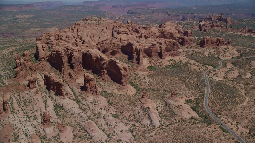 Approach Elephant Butte and Double Arch, Arches National Park, Utah Aerial Stock Footage | AX137_070
