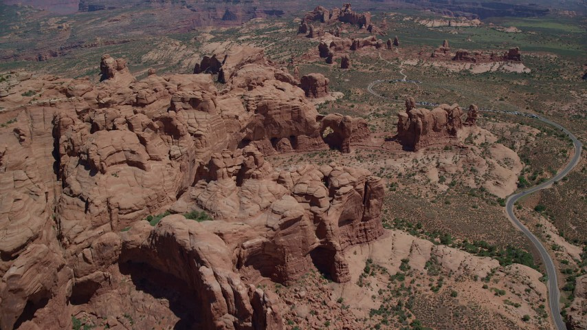 Fly over and tilt down on Elephant Butte and Double Arch, Arches National Park, Utah Aerial Stock Footage AX137_071