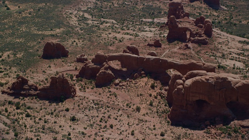 North Window, South Window and Turret Arch Rock Formations, Arches National Park, Utah Aerial Stock Footage | AX137_074