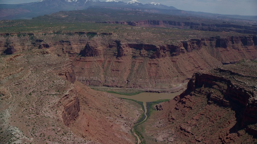 6K stock footage aerial video of Colorado River flowing through a canyon, Arches National Park, Utah Aerial Stock Footage AX137_076 | Axiom Images