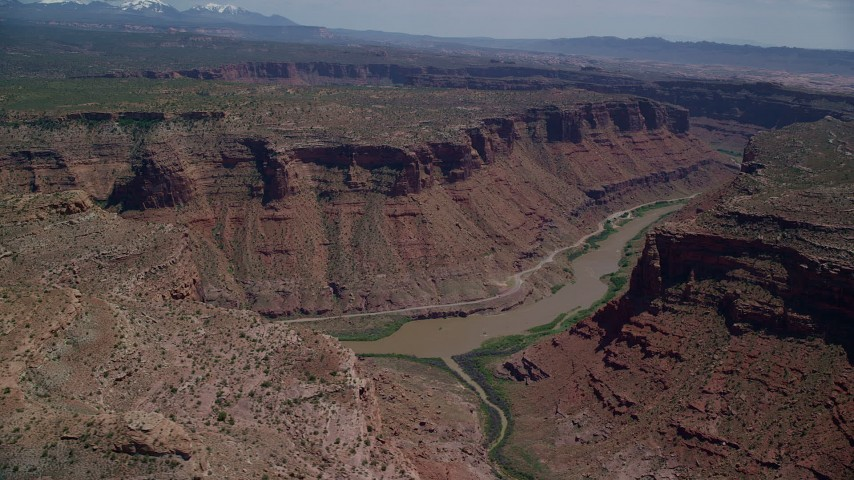 6K stock footage aerial video of the Colorado River and a canyon road, Arches National Park, Utah Aerial Stock Footage | AX137_077