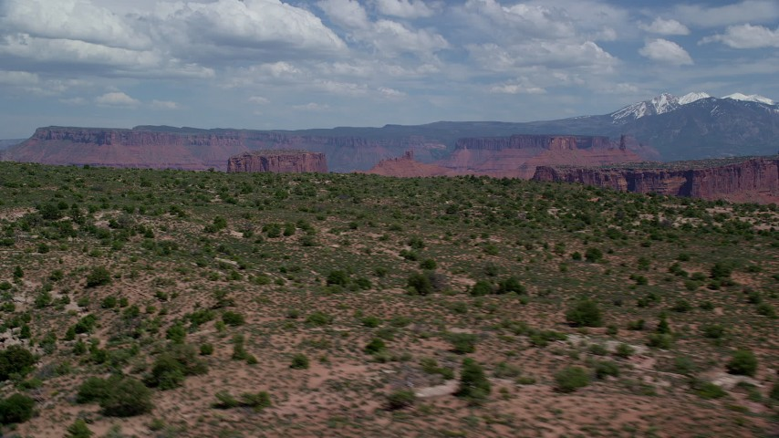 6K stock footage aerial video of mesas and buttes seen from the top of Dry Mesa, Moab, Utah Aerial Stock Footage | AX137_083