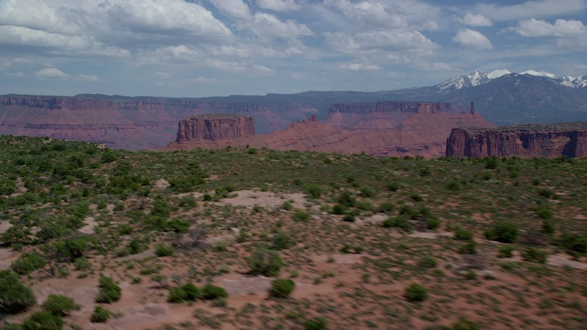Mesas and Buttes seen from Dry Mesa with vegetation, Moab, Utah Aerial Stock Footage | AX137_084