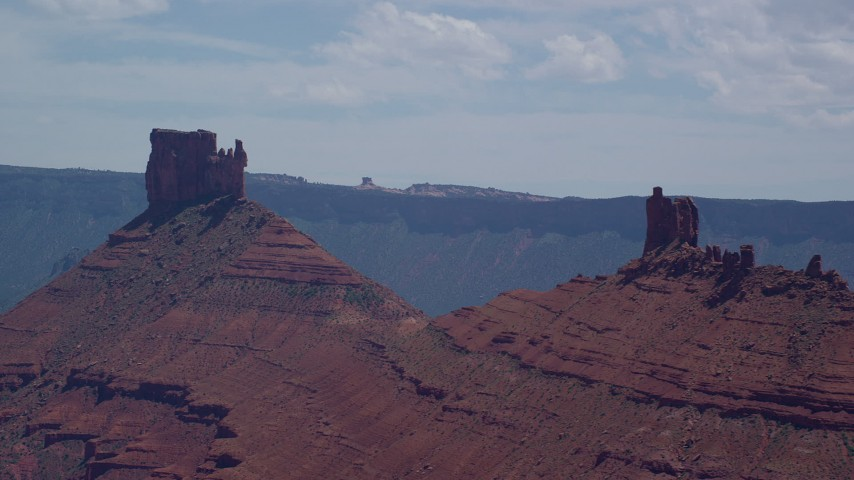 Flying by two buttes, Moab, Utah Aerial Stock Footage | AX137_096