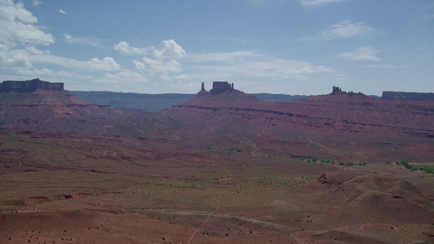 Distant Desert Buttes in Moab, Utah Aerial Stock Footage | AX137_126