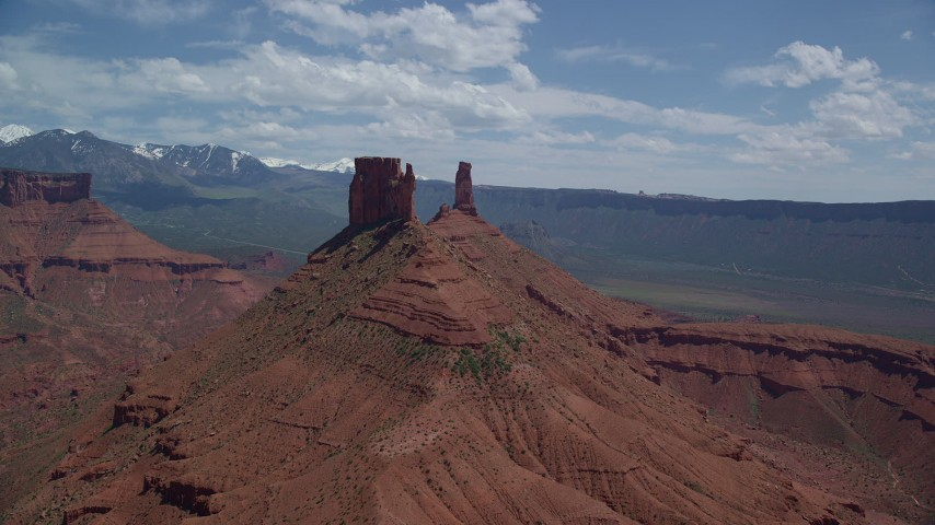 Approaching a Butte and Castleton Tower in Moab, Utah Aerial Stock Footage   AX137_134