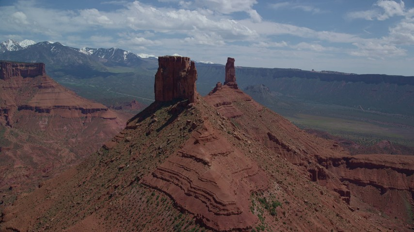 6K stock footage aerial video approach a large butte near Castleton Tower in Moab, Utah Aerial Stock Footage | AX137_135