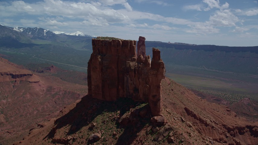Side View of a Tall Butte in Moab, Utah Aerial Stock Footage | AX137_136