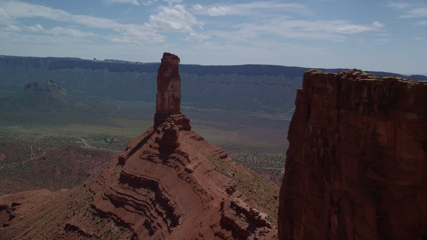 6K stock footage aerial video flyby a butte to approach Castleton Tower in Moab, Utah Aerial Stock Footage | AX137_137