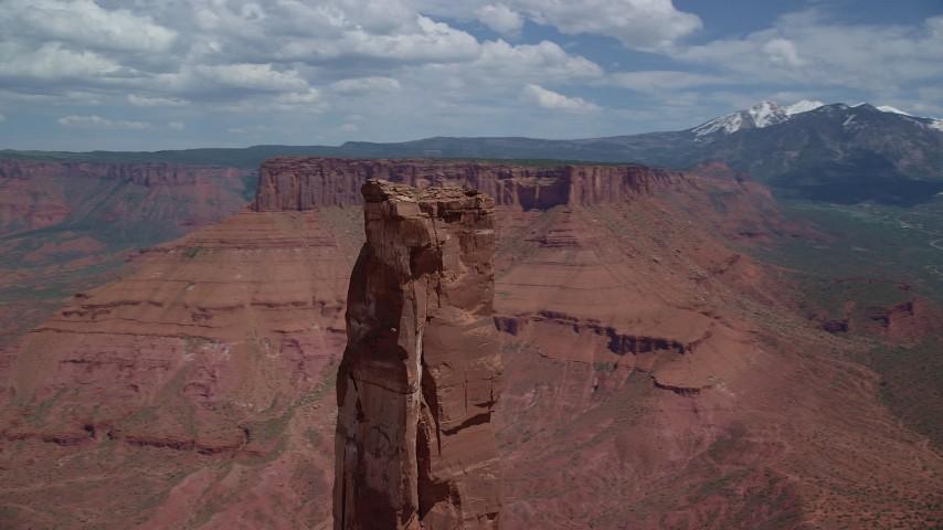 6K stock footage aerial video orbit Castleton Tower to reveal Adobe Mesa in Moab, Utah Aerial Stock Footage | AX137_138