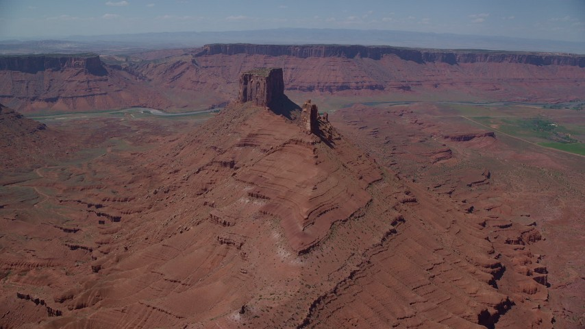 6K stock footage aerial video of approaching a pair of desert buttes in Moab, Utah Aerial Stock Footage | AX137_143