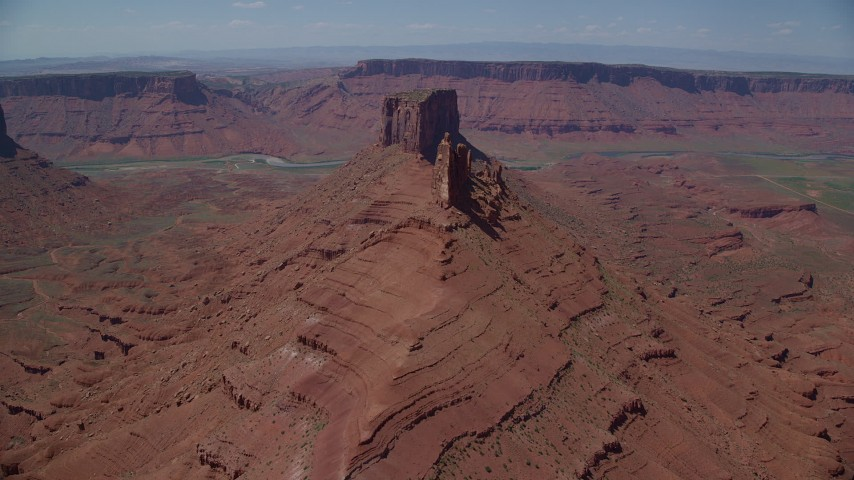 Approach Pair of Buttes in Moab, Utah Aerial Stock Footage | AX137_144