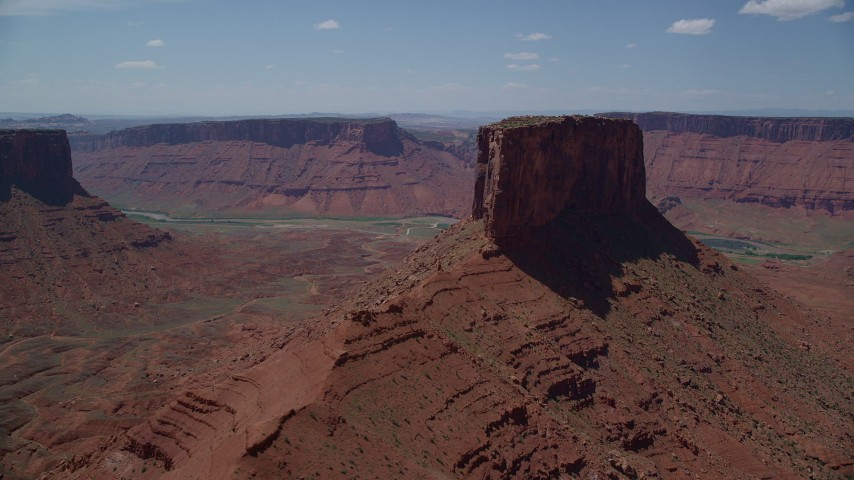 6K stock footage aerial video of approach butte with view of Colorado River and Dry Mesa in Moab, Utah Aerial Stock Footage | AX137_146