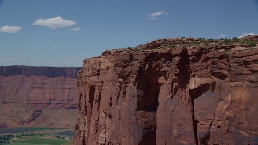 6K stock footage aerial video of orbiting steep butte cliffs in Moab, Utah Aerial Stock Footage | AX137_148