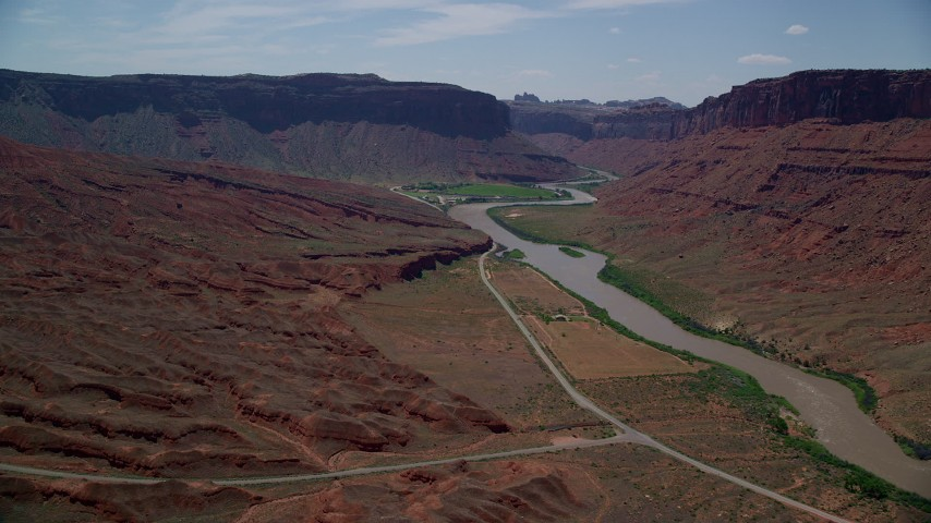 6K stock footage aerial video of flying toward a large mesa by the Colorado River in Moab, Utah Aerial Stock Footage | AX137_151
