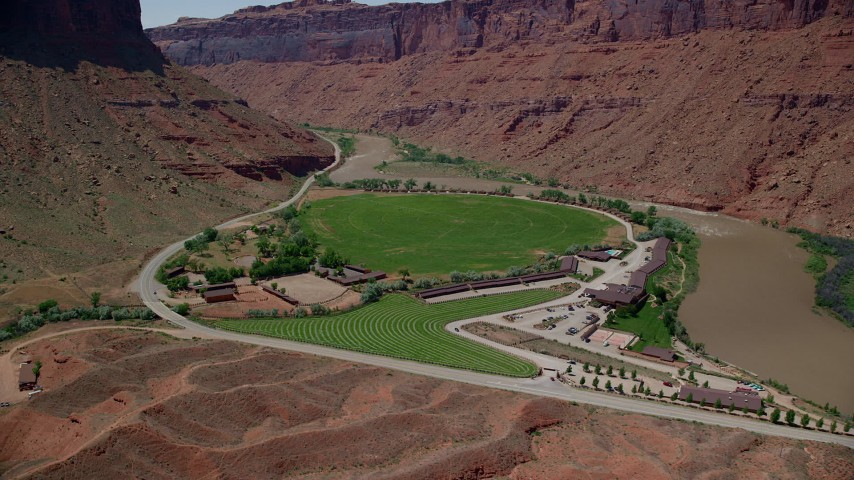 6K stock footage aerial video of a close-up view of Red Cliffs Lodge by the Colorado River in Moab, Utah Aerial Stock Footage | AX137_155
